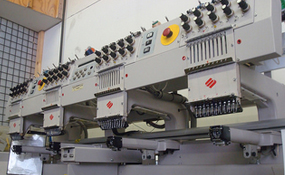 ID#1130 - Melco EMT10/4T Commercial Embroidery Machine.  Year 2000 Heads: 4 Needles: 10 - www.TheEmbroideryWarehouse.com