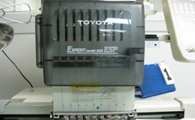 ID#1208 - Toyota 830 ESP Commercial Embroidery Machine.  Year 1996 Heads: 1 Needles: 9 - www.TheEmbroideryWarehouse.com