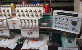 ID#1213 - Tajima TMFXII C1206 Commercial Embroidery Machine.  Year 1997 Heads: 6 Needles: 12 - www.TheEmbroideryWarehouse.com