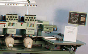 ID# 1288 1992 Tajima TME-HC912  Multi-head commercial embroidery machine http://www.TheEmbroideryWarehouse.com