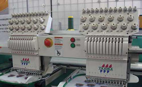 ID#3002 - Tajima TMFXII C1202 Commercial Embroidery Machine.  Year 1997 Heads: 2 Needles: 12 - www.TheEmbroideryWarehouse.com